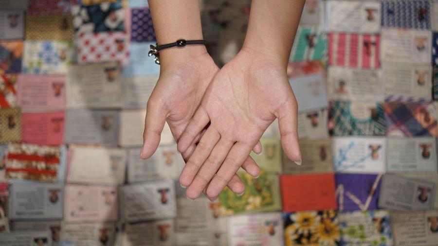 High angle view of human hands