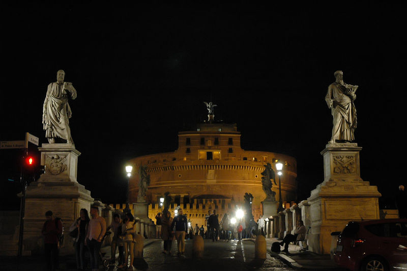 Historical Building Past Architecture City Life History Human Representation Illuminated Large Group Of People Night People Saint Angelo Castle Sculpture Statue Tourism Attraction Travel Destinations