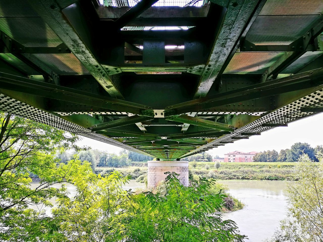 HIGH ANGLE VIEW OF BRIDGE OVER RIVER WITH TREES