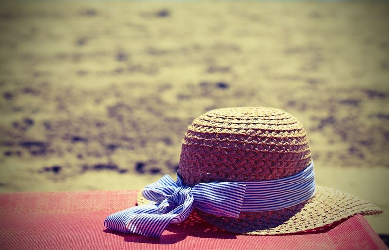 Close-Up Of Hat On Table At Beach