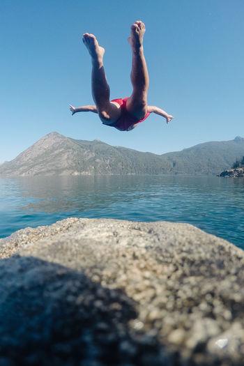 Man jumping in sea