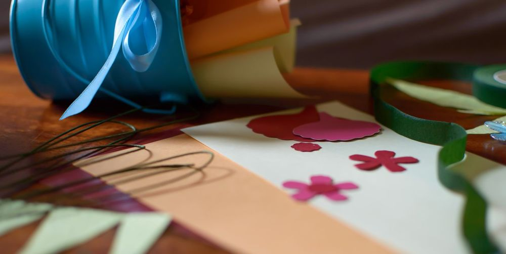 Close-up of colorful papers on table