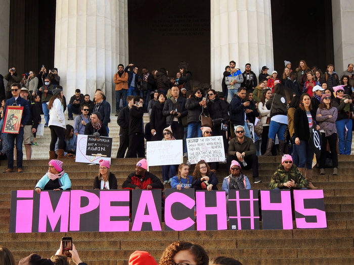 Protesters and signs gathered on the steps of the Lincoln Memorial at the Women's March in Washington, DC. on Saturday, January 20, 2018. Their sign is calling for the impeachment of President Donald Trump. 2018 National Mall, Washington, DC Resistance Washington, D. C. Adult anti-Trump protest Architecture building exterior communication day large group of people men outdoors people placard protesters prote Impeachment 2018 National Mall, Washington, DC Resistance  Washington, D. C. Adult Anti-Trump Protest Architecture Building Exterior Communication Day Large Group Of People Men Outdoors People Placard Protesters Protestor Real People Standing Text Women Women's March