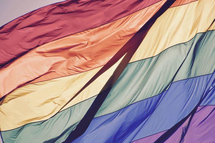 Low angle view of rainbow flag