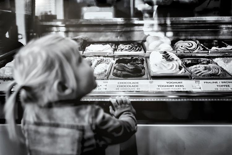Girl at ice cream parlour