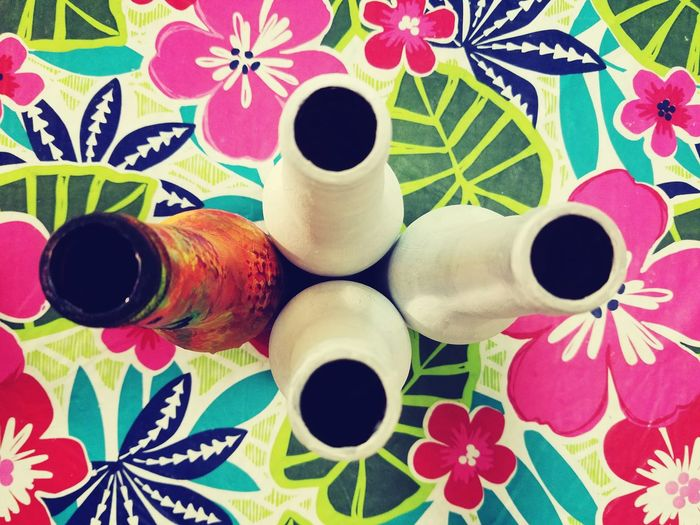 Feel The Journey Bottles Collection Pattern Floral Pattern Tablecloth Centerpiece Bottle Art One Singled Out Bottle decoration on a Table.