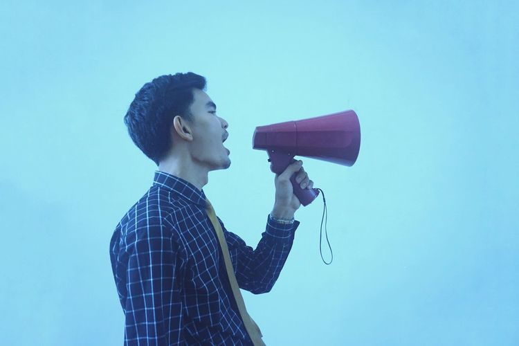 Man with Megaphone Megaphone Yell Bawl Man Call Voice Businessman Microphone Men Singing Studio Shot Shouting Business Business Finance And Industry Singer  Technology Screaming Noise