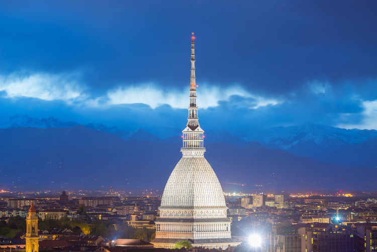 La mole antonelliana in city against sky at dusk