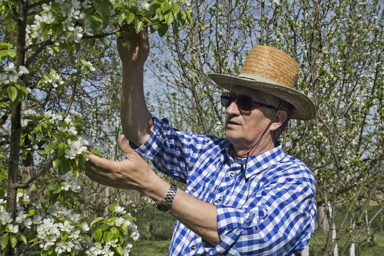 Full length of man wearing hat in farm