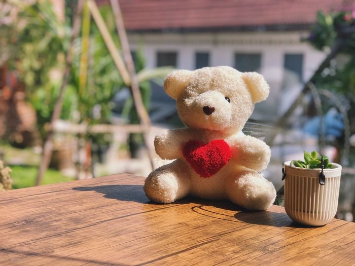 Close-up of teddy bear on table at yard