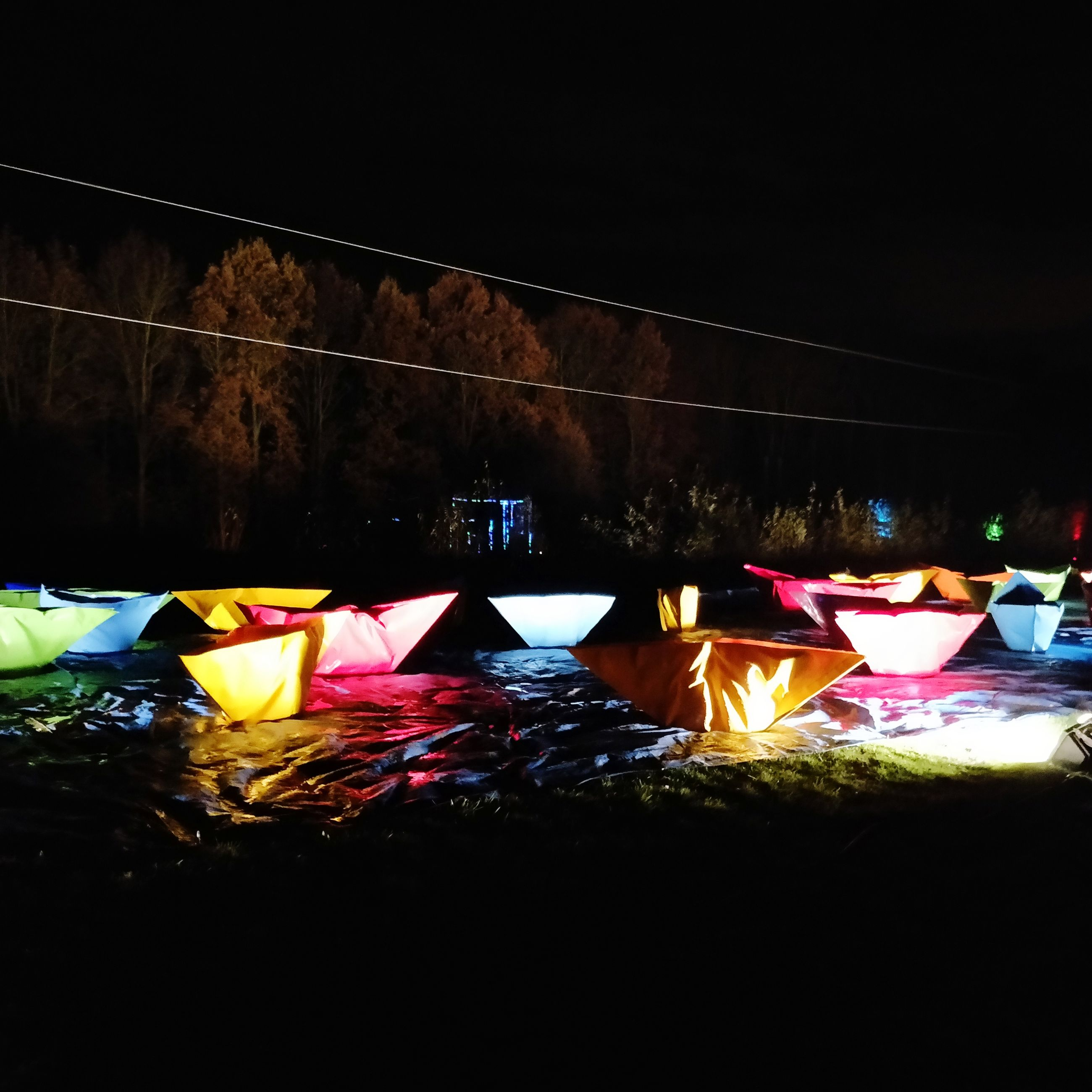 multi colored, illuminated, night, no people, glowing, nature, decoration, water, celebration, outdoors, hanging, lighting equipment, tent, land, burning, bunting, fire, copy space, dark, paper lantern