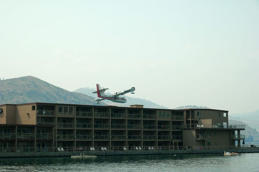 Airplane Plane Hotel Motel Condos Close Close Call Scary Too Close Too Close For Comfort Amazing Feat Skimming Crazy Crazy Moments Extreme The Photojournalist - 2016 EyeEm Awards Risky Risky Business Adventure Waterplane Lake Lake View FireFighting  Urban Lifestyle #urbanana: The Urban Playground