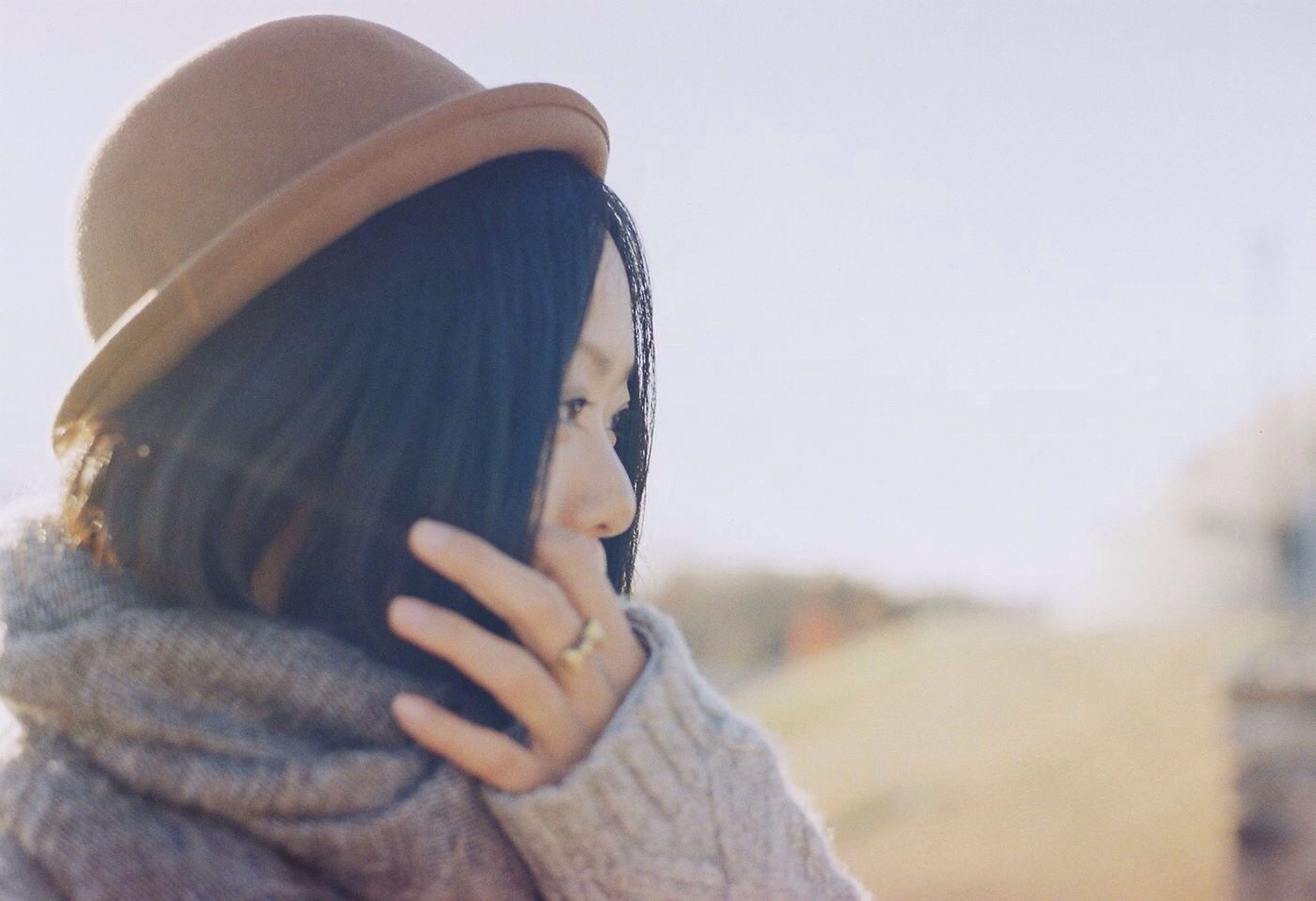 lifestyles, leisure activity, focus on foreground, holding, headshot, men, clear sky, person, close-up, cropped, part of, sky, outdoors, day, waist up, hat, unrecognizable person