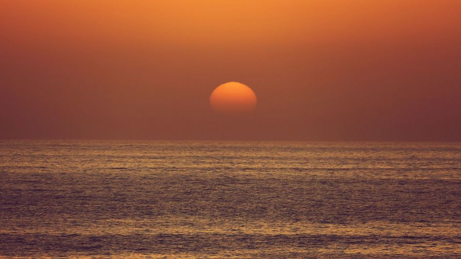 Sunset Nature Tranquility No People Beauty In Nature Outdoors Sky Day Calm Water Calm Seas Calmness