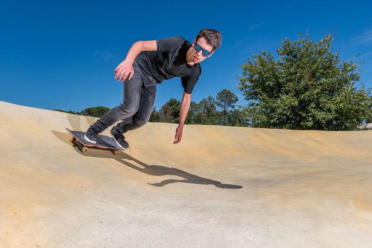 Full length of man skateboarding in park