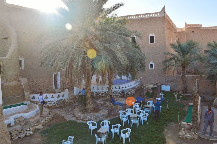 Libya Ghadames Grass Sun Palm Tree Tojada_cafe Traditional Tradition Heritage Sun Light Light Lines Chair Table Archaeological Nikon D3200 Snapseed Libya Nature  This Is Libya <3<3  Swing Sky And Clouds Hello World Oldcity Libyan Having Fun Enjoying Life