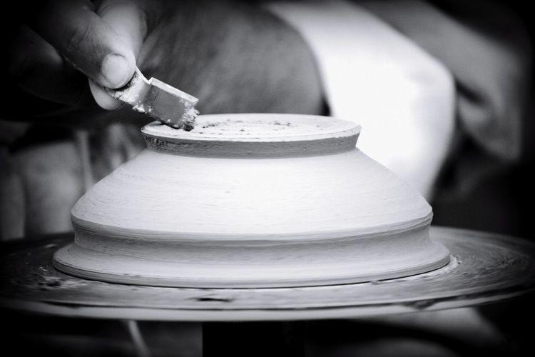 Close-up of person preparing tea cup
