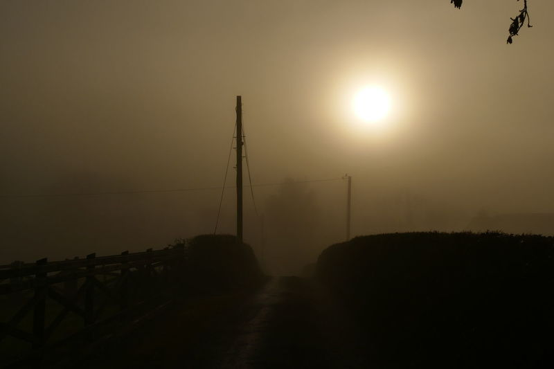 Foggy day.. Beauty In Nature Cable Dream States Electricity  Electricity Pylon Ethereal Fog Foggy Foggy Weather Landscape Nature No People Outdoors Scenics Silhouette Silhouette_collection Sky Softness Sun Sunset Tranquil Scene Tranquility