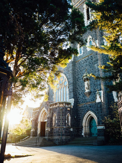 Architecture Building Exterior Church Light And Shadow Low Angle View Old Buildings Outdoors Place Of Worship Suburb Sunlight Sunset Sunshine