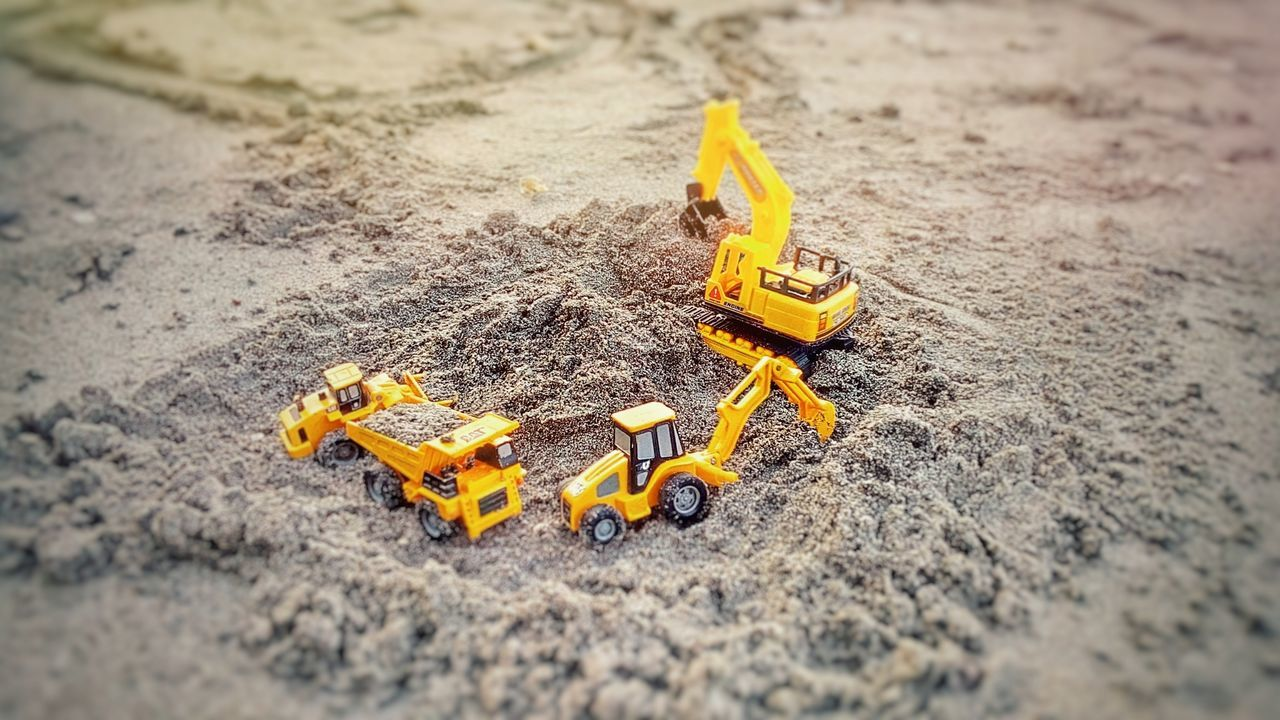 toy, sand, toy car, selective focus, yellow, high angle view, no people, childhood, close-up, outdoors, day