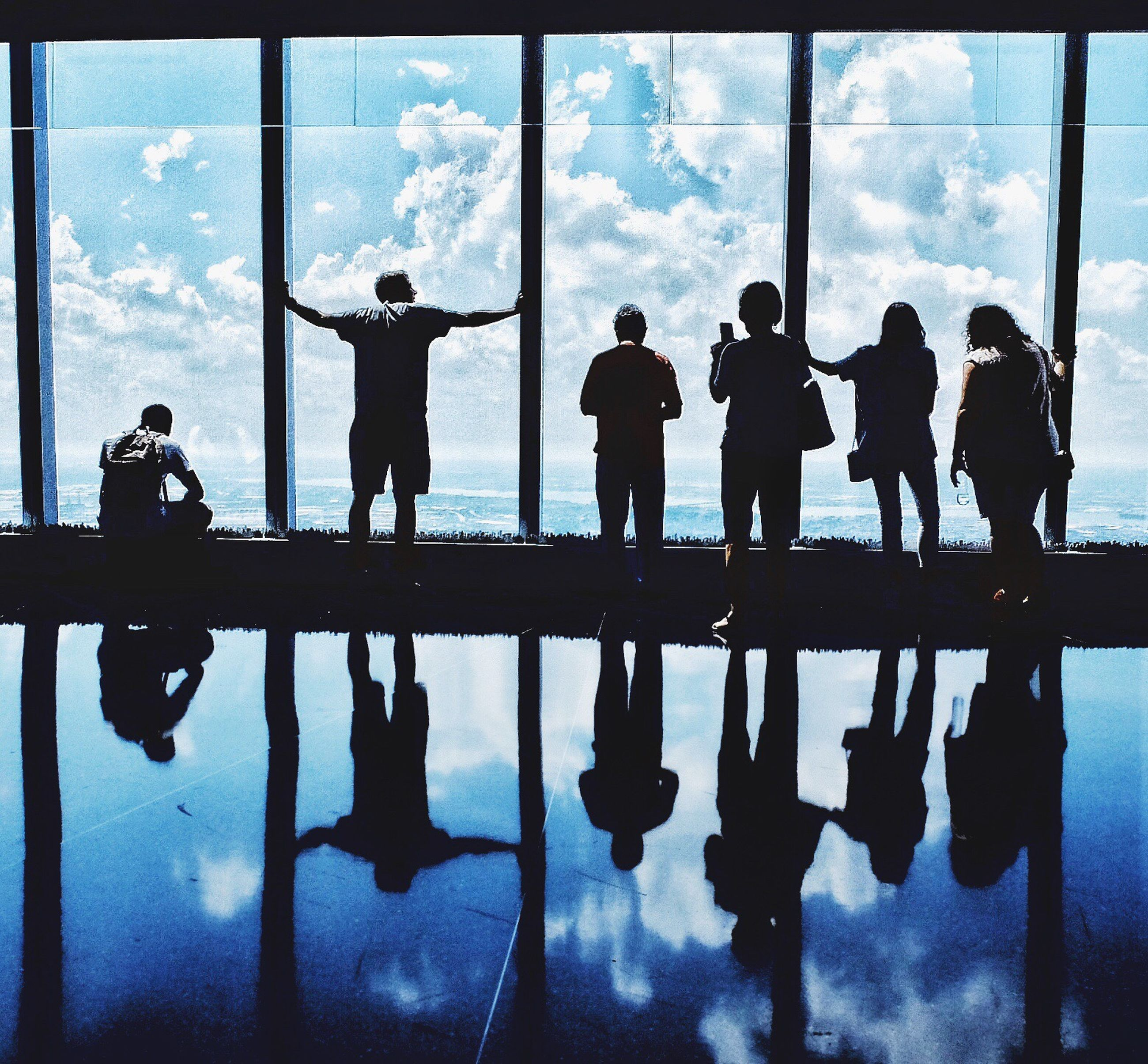 silhouette, reflection, person, indoors, men, leisure activity, lifestyles, water, standing, cloud - sky, togetherness, sky, vacations, tourism, cloud, day, famous place, children only