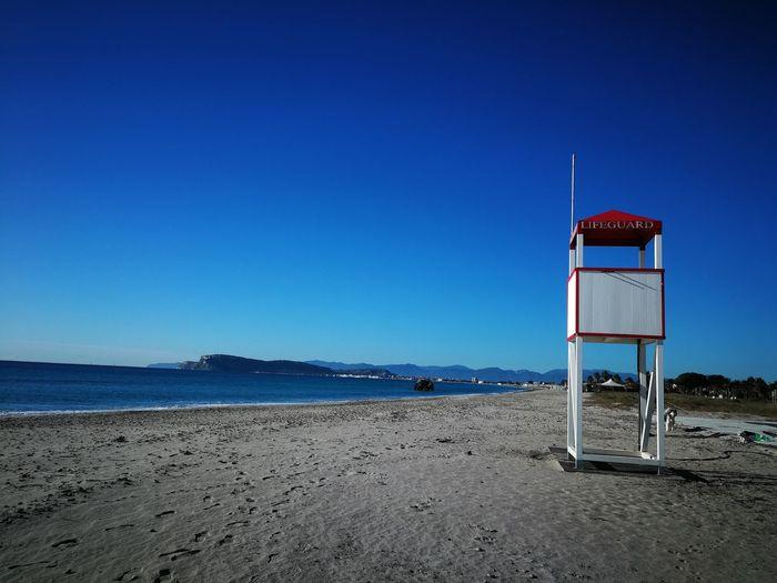 EyeEm EyeEm Selects EyeEm Gallery Sardinia Sardegna Italy  Sardinia Sardegna Water Sea Beach Clear Sky Sand Blue Lifeguard  Summer Lifeguard Hut Protection Shore Calm Tranquil Scene Scenics Tranquility Idyllic