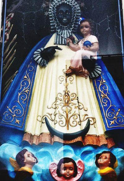 Madonna in the window. Storewindows Religion Walking Around Just Looking