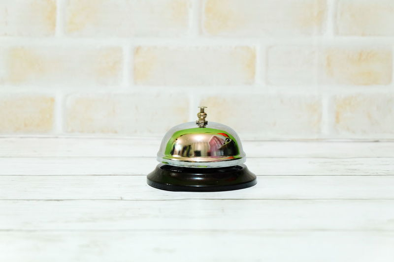 Ring bell on a table. No People Office Ring Bell Bell Front Counter Front Desk Hotel Motel Lobby Ring Metal Reflection Alarm Ting Object Backgrounds