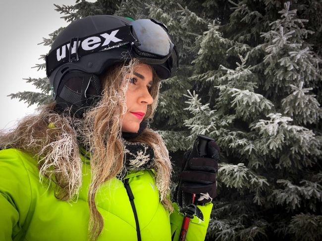 Portrait of woman wearing Uvex ski glasses and Uvex ski helmet and holding ski poles with pine cone trees covered in snow in the background Portrait Face Ski Helmet Ski Glasses Uvex Evergreen Trees Forest Skiing Skier Winter Cold Temperature Jacket Warm Clothing One Woman Only Snow Only Women Adult Outdoors One Person Day Women Adventure People Real People Adults Only Nature Happiness Headwear Beautiful Woman