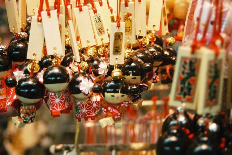 Traditional japanese wooden toy doll charms