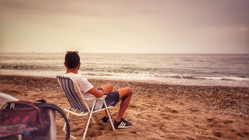 EyeEm Selects Beach Sea Sitting Sand Vacations People Relaxation Enjoyment Sunset Horizon Over Water Summer