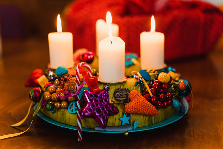Christmas Decoration Christmas Decoration Christmas Festive Decoration Candle Celebration Burning Food And Drink Multi Colored Fire Flame Food Indoors  Sweet Food Birthday Event No People Sweet Illuminated Fire - Natural Phenomenon Holiday - Event Holiday Birthday Candles Temptation Garnish