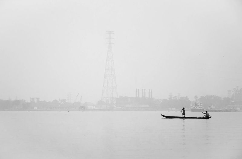 People on river against sky