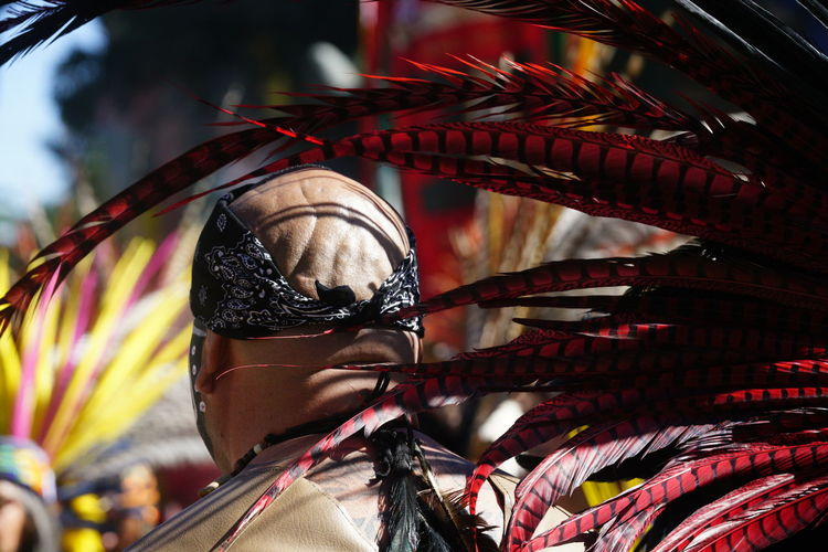 Aztec dancer at a public event sharing culture and tradition at Chicano Park in San Diego, California Aztec Dancers Immigration Aztec Aztec Indian Sculpture Azteca Border Celebration Ceremony Close-up Culture Cultures Day Ethnic Festival Focus On Foreground Immigration Reform Low Angle View Mexican Multi Colored One Person Outdoors Real People Tradition Traditional Clothing Traditional Festival