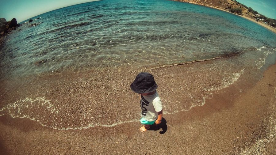 Little Boy On The Beach Seashore Summer Views Summertime Feel The Journey Original Experiences Childhood From My Point Of View Children Photography Kids Being Kids Beach Life Beachphotography Planet Earth Simple Things In Life Simple Moment From Where I Stand Sandy Beach Seaside Boy Passing By People Of The Oceans - Greek Islands Chios Greece
