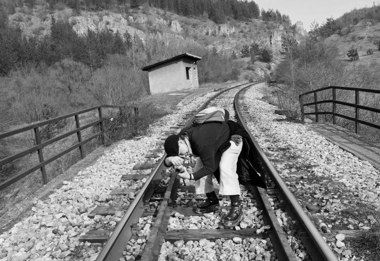 A woman on the rails Outdoors Nature Landscape Landscape_Collection Nature_collection Nature Photography Nature Lover Architecture Railing One Person The Way Forward Real People Direction Woman Blackandwhite Black And White Monochrome Photographer Photography Photography Themes Lifestyles Taking Photos Train Rail Railroad Rails A New Perspective On Life Humanity Meets Technology The Traveler - 2019 EyeEm Awards