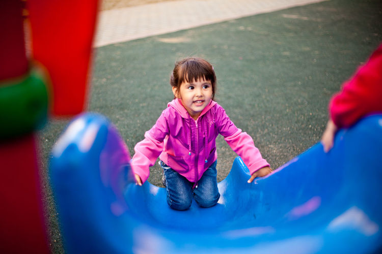 Close-up of girl playing in playground