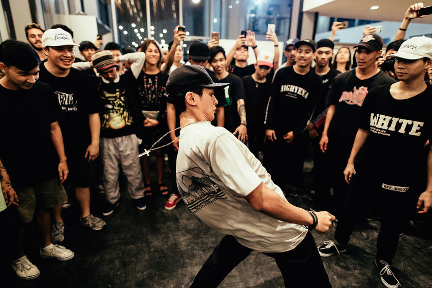 BBOY Dance Aggression  Artist Arts Culture And Entertainment Casual Clothing City Communication Concert Crowd Enjoyment Event Full Length Fun Group Of People Large Group Of People Men Music Outdoors Performance Real People Rock Music Stage Standing Street