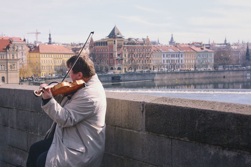 A romantic solo scene. Architecture Arts Culture And Entertainment Building Exterior Built Structure City Cityscape Lifestyles Music Musical Instrument Musician One Person Playing Real People Street Art String Instrument Violin Violinist The Street Photographer - 2018 EyeEm Awards