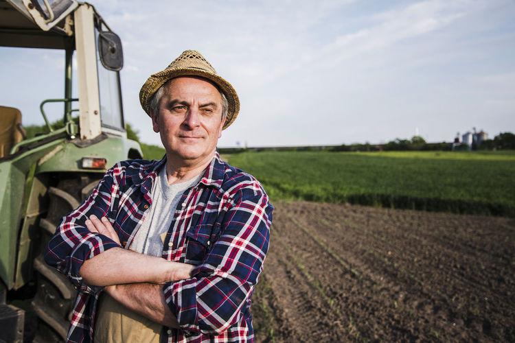 Portrait of smiling man standing in field