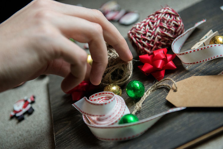 Christmas is presents time Gold Horizontal New Year Ornament Presents Background Candy Celebration Christmas Christmas Decoration Close-up Colorful Day Full Frame Gift Gift Ribbon Gifts Human Body Part Human Hand Indoors  One Person Present Real People Table Time