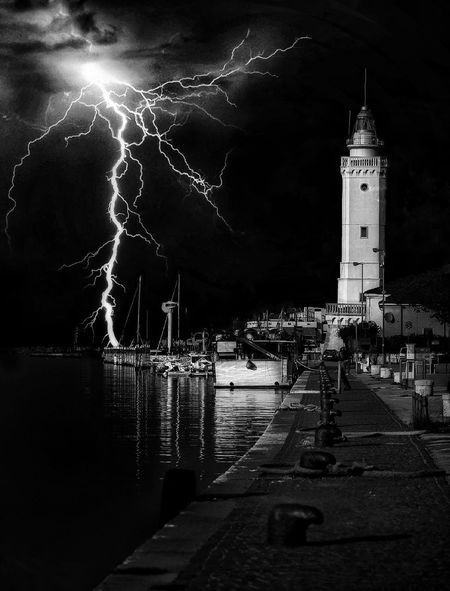 The Storm is coming up Storm Light Fulmini Lighthouse Thunder Thumderstorm Building Exterior Architecture Water Built Structure Tower Building Night