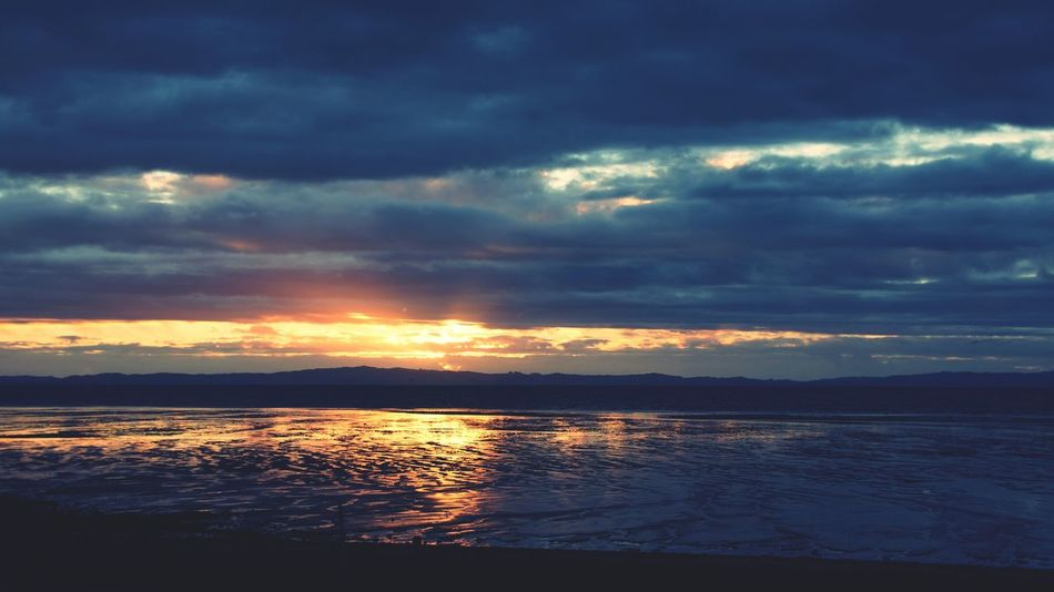 colour mix of a sunset Colour Your Horizn Sunset Cloud - Sky Reflection Dramatic Sky Nature Water Outdoors Scenics No People Sea Landscape Tranquility Sky Beauty In Nature Travel Destinations Multi Colored Vacations Low Tide