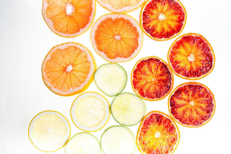 Directly above shot of orange slices against white background