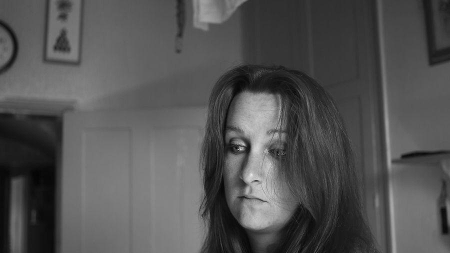 Woman looking away in bedroom