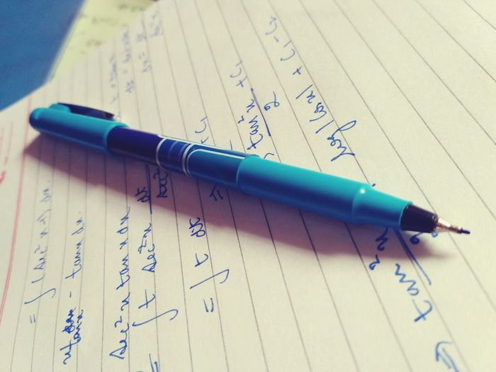 Close-up of pen on page