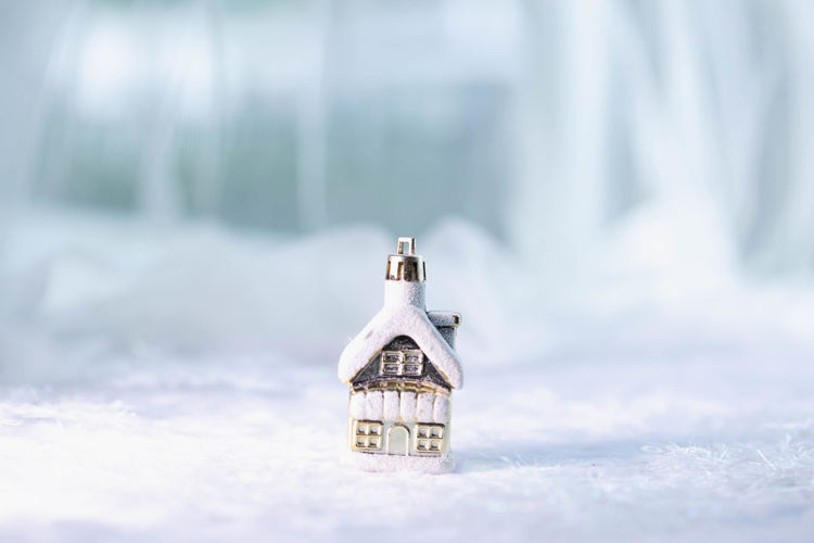 Close-up of snow covered house