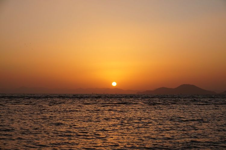 The last sunset of 2017 Reflection Wave Sunset Beauty In Nature Sun Scenics Sea Tranquility Tranquil Scene Nature Orange Color Sky Water Horizon Over Water Waterfront No People Outdoors
