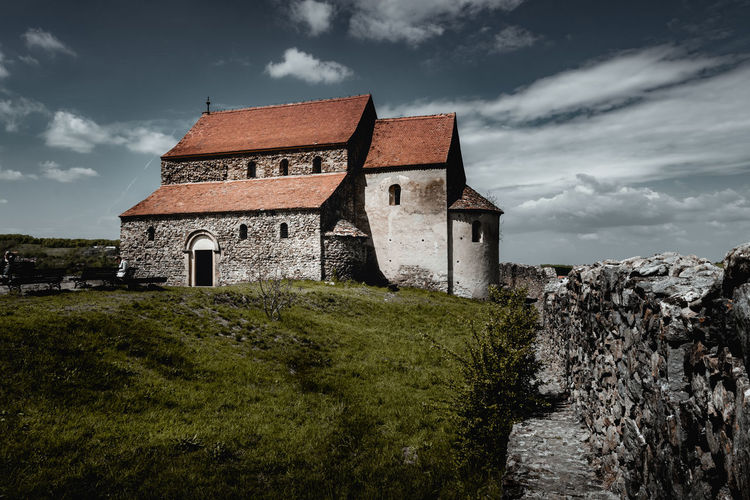 Fortified History Architecture Built Structure Cloud - Sky Building Exterior Sky Building The Past Nature History Grass No People Plant Religion Place Of Worship House Land Day Belief Spirituality Outdoors Stone Wall Nikon D7500 Sibiu Romania Wall Old Medieval Summer Morning Mood Bestoftheday