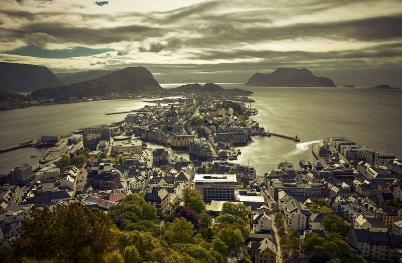 Alesund - Norway Architecture Bay Beauty In Nature Building Building Exterior Built Structure City Cityscape Cloud - Sky Day High Angle View Mountain Mountain Range Nature No People Outdoors Residential District Scenics - Nature Sea Sky TOWNSCAPE Water